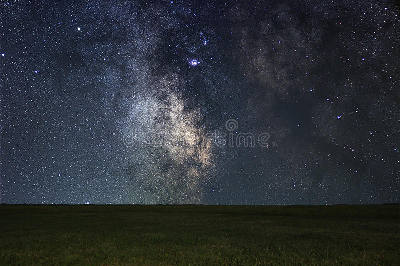 Night landscape with colorful Milky Way over meadow. stock image