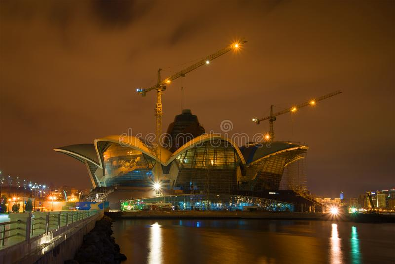 Night landscape construction of a new shopping center on the embankment of the Baku bay. BAKU, AZERBAIJAN - DECEMBER 29, 2017: Night landscape construction of a stock images