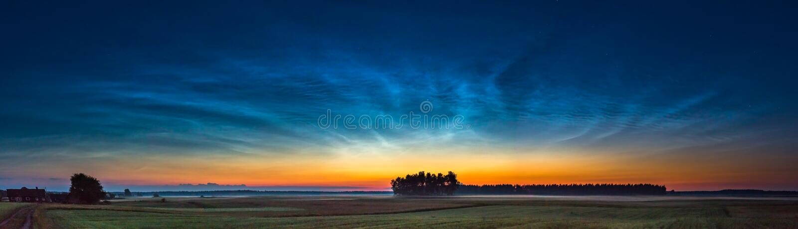 Night landscape with electric line and Noctilucent clouds stock images