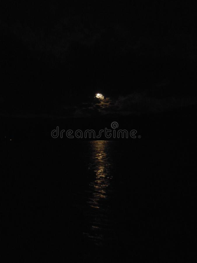 night landscape.the lunar path is reflected on the water of the sea. stock photography