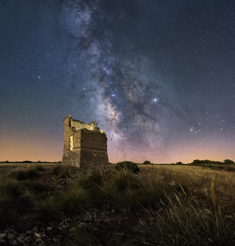 Night landscape with the Milky way over an old castle stock photography