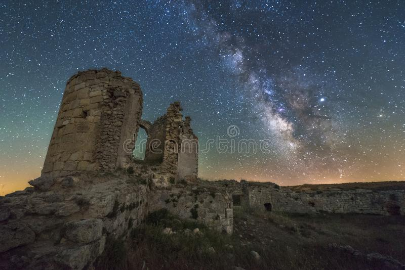 Night landscape with the Milky way over an old castle stock photos