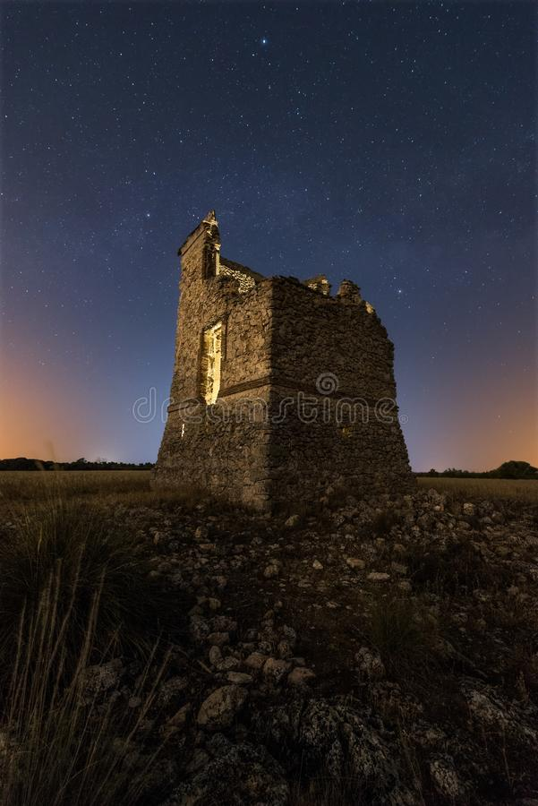 Night landscape with the Milky way over an old castle stock photo