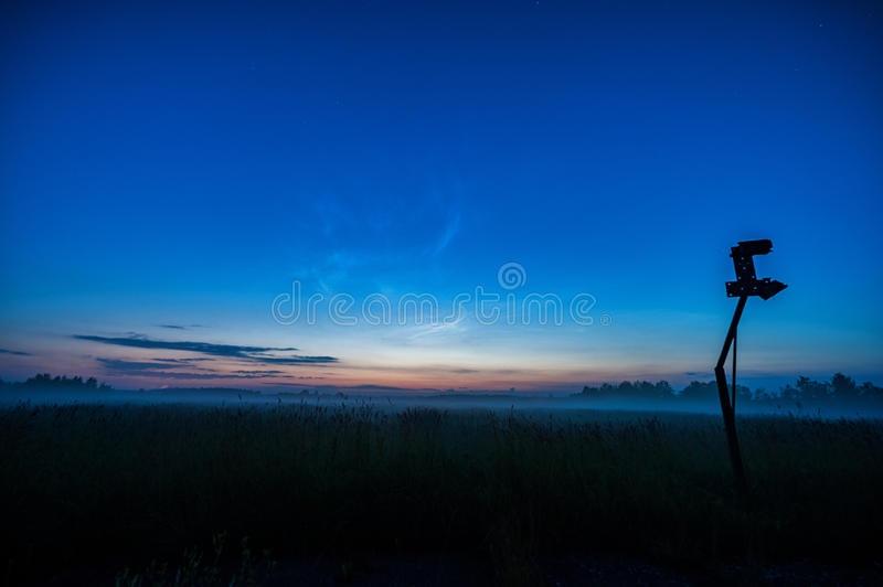 Night Landscape with Mist and Clear Blue Sky. Old Basketball Construction in background. Night Landscape with Mist and Clear Blue Sky stock images