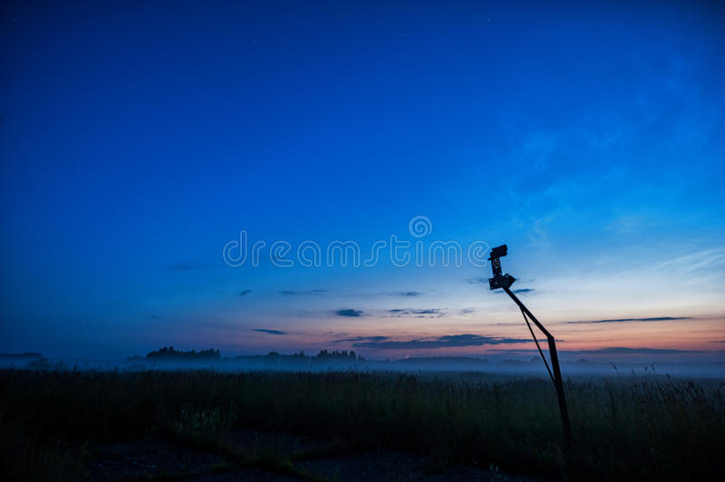 Night Landscape with Mist and Clear Blue Sky. Old Basketball Construction in background. Night Landscape with Mist and Clear Blue Sky stock image