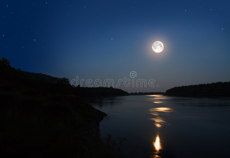 Night landscape with moon. And moonbeam in river royalty free stock image