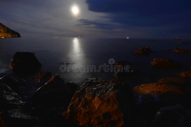 Night landscape. Moon over blue water. Night landscape royalty free stock photography
