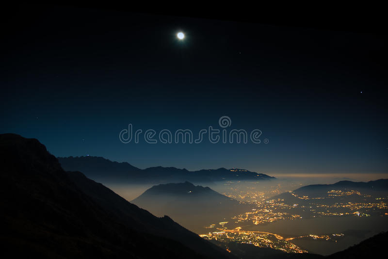 Night landscape mountains with moon. Night view of the valley of Civate, from Mount Cornizzolo, Lecco, Italy stock images