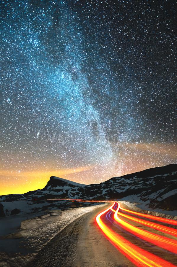 Free Night Landscape. Night Sky With A North Hemisphere Milky Way And Stars. The Night Road Illuminated By The Car Winds With Stock Image - 110120891