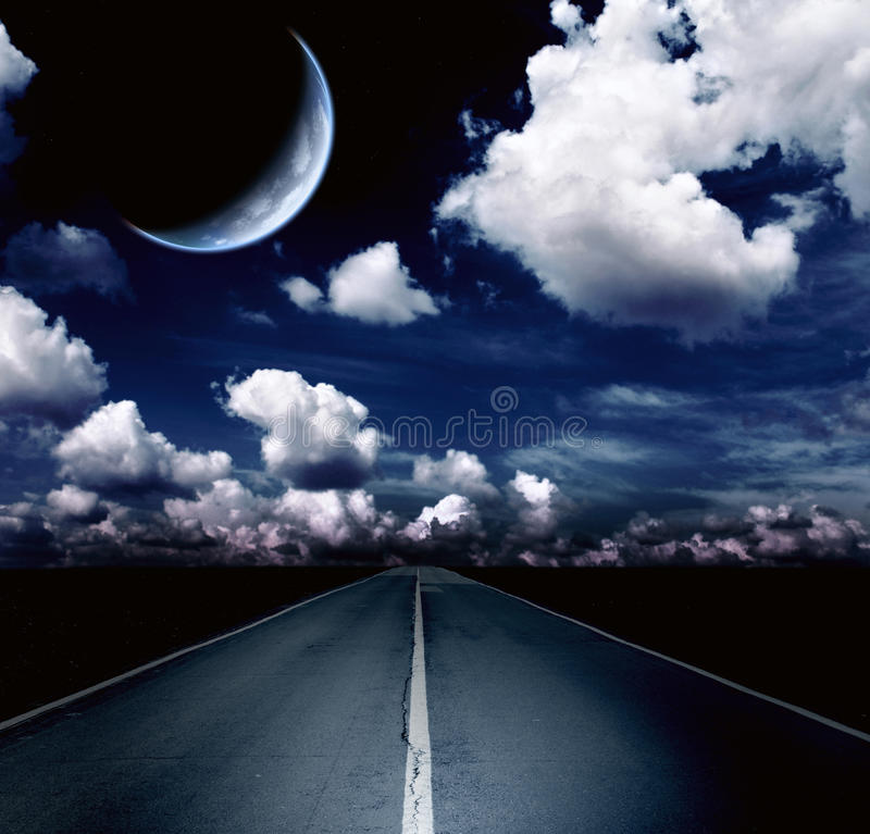 Night landscape with road, clouds and the moon stock photo