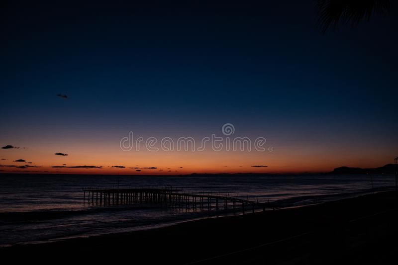 Night landscape, sea, palm trees, sunset, beach, sky, waves, landscape, travel, peace, nature, environment, beautiful views royalty free stock photography