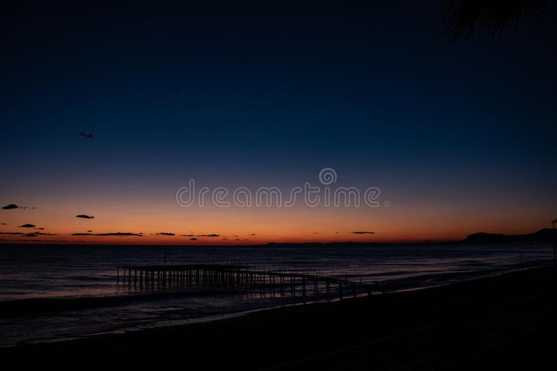 Night landscape, sea, palm trees, sunset, beach, sky, waves, landscape, travel, peace, nature, environment, beautiful views royalty free stock photos