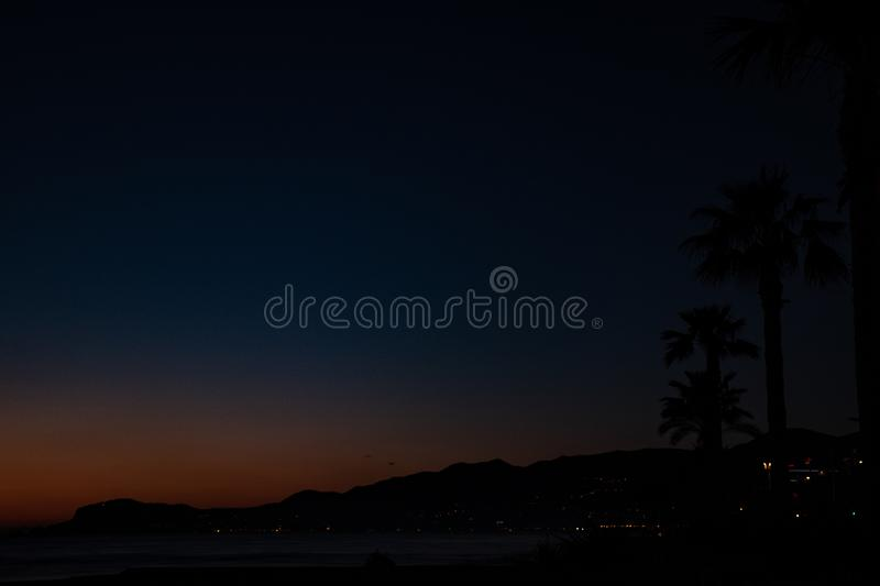 Night landscape, sea, palm trees, sunset, beach, sky, waves, landscape, travel, peace, nature, environment, beautiful views stock photos