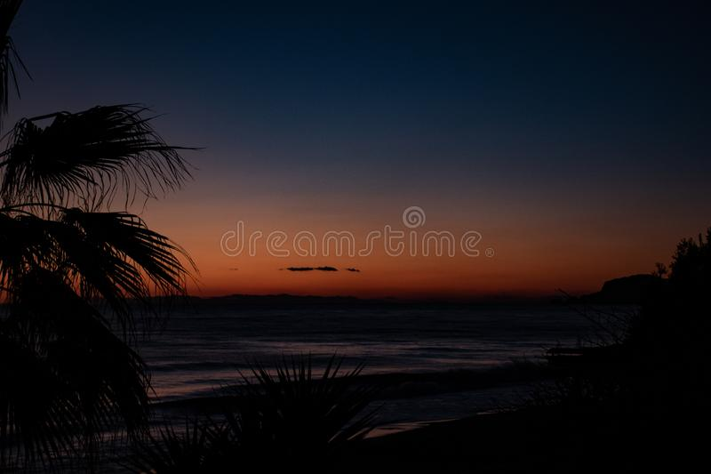 Night landscape, sea, palm trees, sunset, beach, sky, waves, landscape, travel, peace, nature, environment, beautiful views royalty free stock image