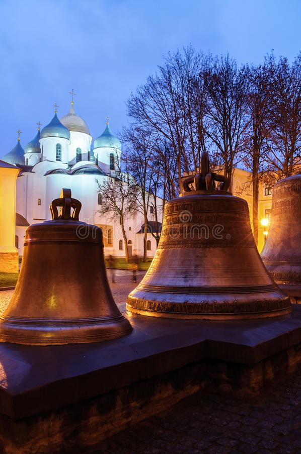Night landscape - St Sophia cathedral and veche metal bells in Veliky Novgorod Kremlin park. Veliky Novgorod, Russia. Night landscape - St Sophia cathedral and stock image