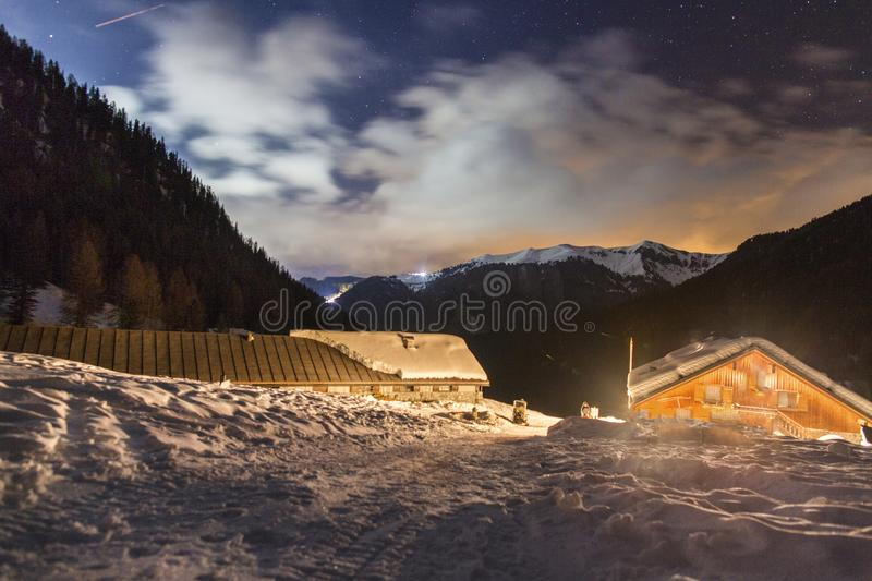 Night landscape of the winter mountains. Starry sky in the snow-capped mountains of Europe. Winter Alps in Trentino Alto Adige. Do royalty free stock image