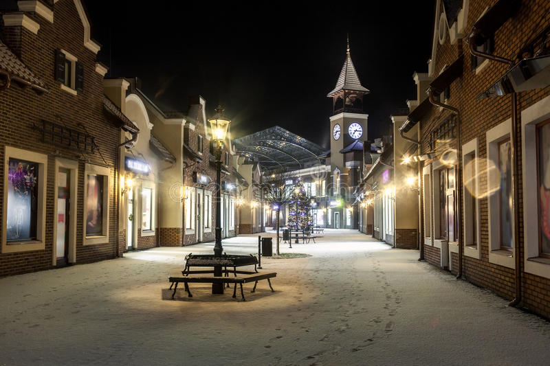 Night landscape of winter street with tower clock. Beautiful night landscape of winter street with tower clock royalty free stock photos