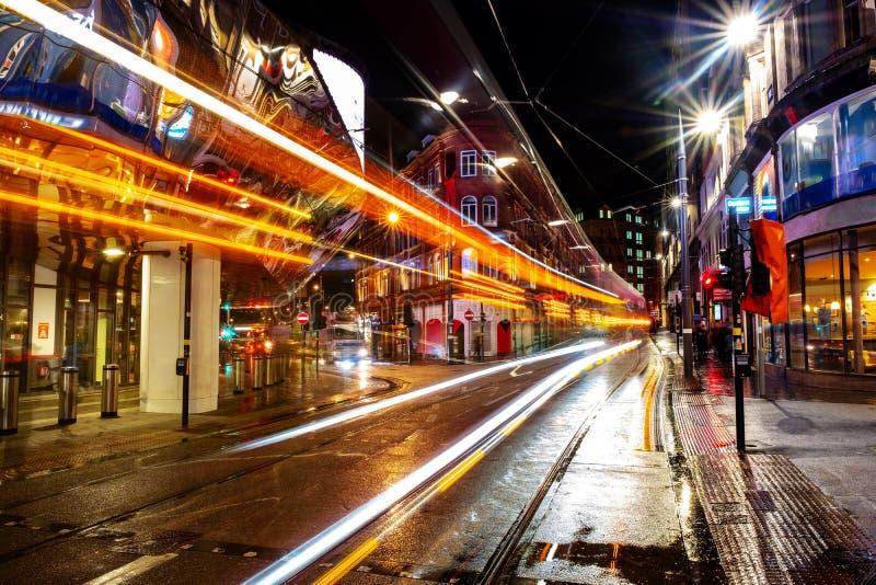 Night life in the center of Birmingham, UK. Dark black sky. Birmingham, UK. Night life in the center of Birmingham, UK. Dark black sky with illuminated buildings stock photography