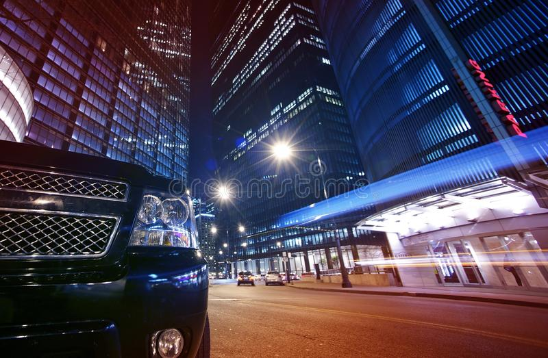 Night Life Chicago. Long Exposure Street Traffic Downtown Chicago with Front of Black SUV. Wide Angle Photography royalty free stock photo