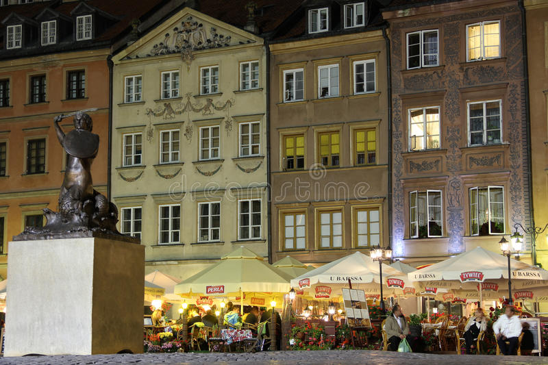 Night life at Market square in the old town. Warsaw. Poland. Market square in the Old town at night is a meeting point for turists and locals to enjoy a meal in royalty free stock photography