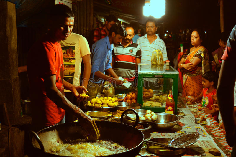 Night life in a Street food stall. People working at a night street food stall serving customer in Alipurduar, India
