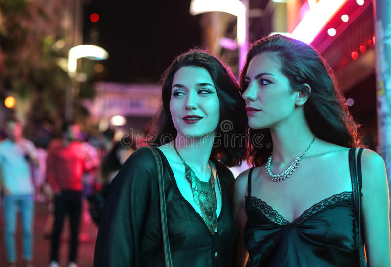 Night life. Two friends going out together enjoying some night life royalty free stock photo
