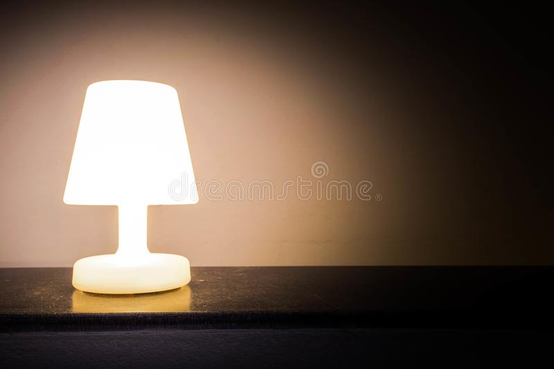 Night light lamp dark shadow background vintage effect. Night light lamp dark shadow background abstract royalty free stock images