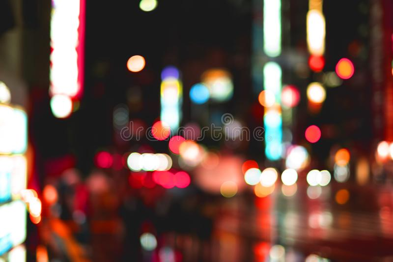 Night light and raindrop blur bokeh background on city street. Abstract pattern of night light and raindrop blur bokeh background on city street with different royalty free stock image