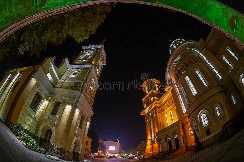 Night lighting with the arch of reconciliation, Caransebes, Romania. Night lighting with the arch of reconciliation between the Orthodox and the Catholic Church stock image