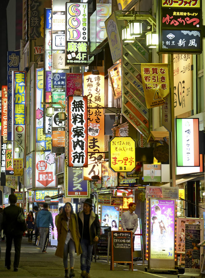 Night lights in the city, Tokyo, Japan. TOKYO – CIRCA NOVEMBER 2014. Despite reports of a slowing Japanese economy, the neon lights of Shinjuku reflect a royalty free stock photos