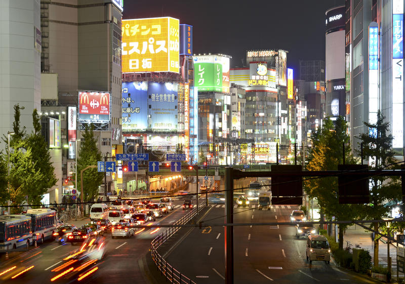 Night lights in the city, Tokyo, Japan. TOKYO – CIRCA NOVEMBER 2014. Despite reports of a slowing Japanese economy, the neon lights of Shinjuku reflect a stock photos