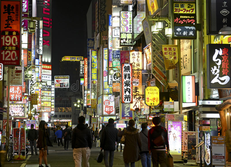 Night lights in the city, Tokyo, Japan. TOKYO – CIRCA NOVEMBER 2014. Despite reports of a slowing Japanese economy, the neon lights of Shinjuku reflect a stock photo
