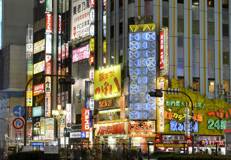 Night lights in the city, Tokyo, Japan. TOKYO – CIRCA NOVEMBER 2014. Despite reports of a slowing Japanese economy, the neon lights of Shinjuku reflect a stock images