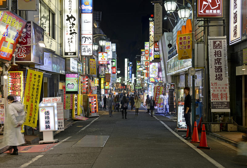 Night lights in the city, Tokyo, Japan. TOKYO – CIRCA NOVEMBER 2014. Despite reports of a slowing Japanese economy, the neon lights of Shinjuku reflect a royalty free stock photography