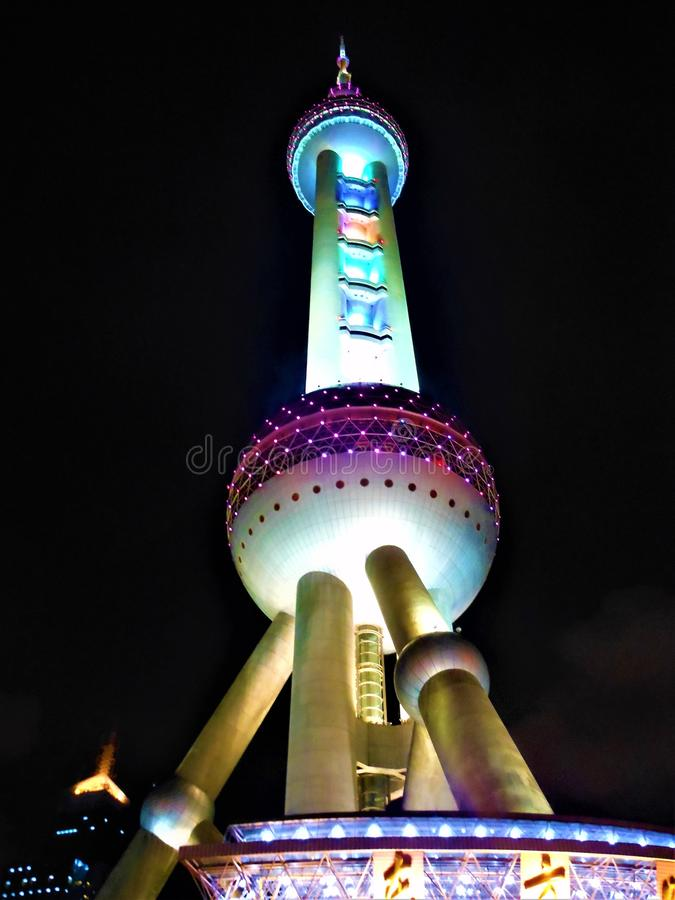Night, lights and colours in Shanghai. Oriental Pearl Tower. Luxury, power, art and architecture, urban design and modern building into the darkness, touristic stock photo