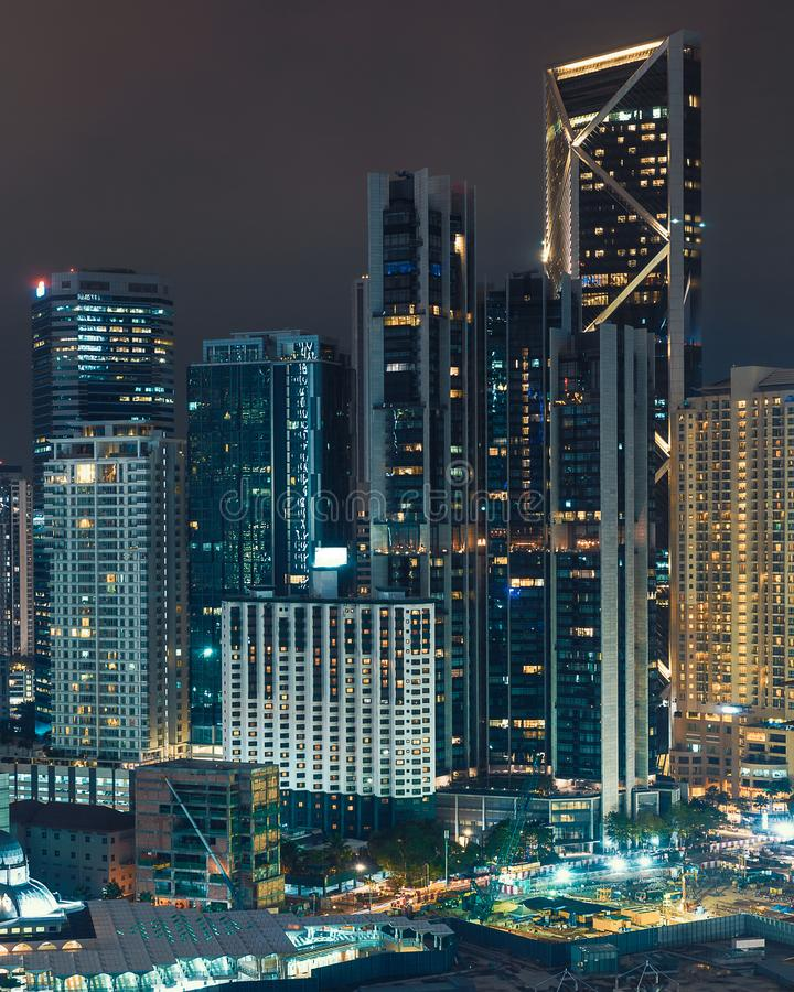 Night lights of Kuala Lumpur office buildings. In city center royalty free stock photo