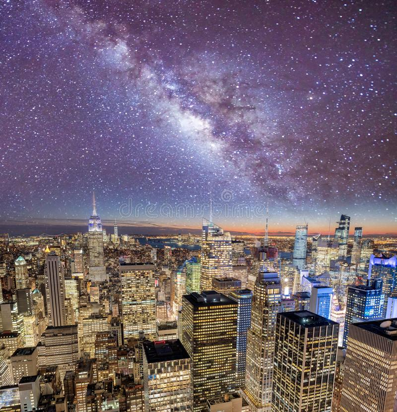 Night lights of Midtown Manhattan skyscrapers. Sunset aerial view of New York City buildings and skyline. Night lights of Midtown Manhattan skyscrapers. Starry royalty free stock image