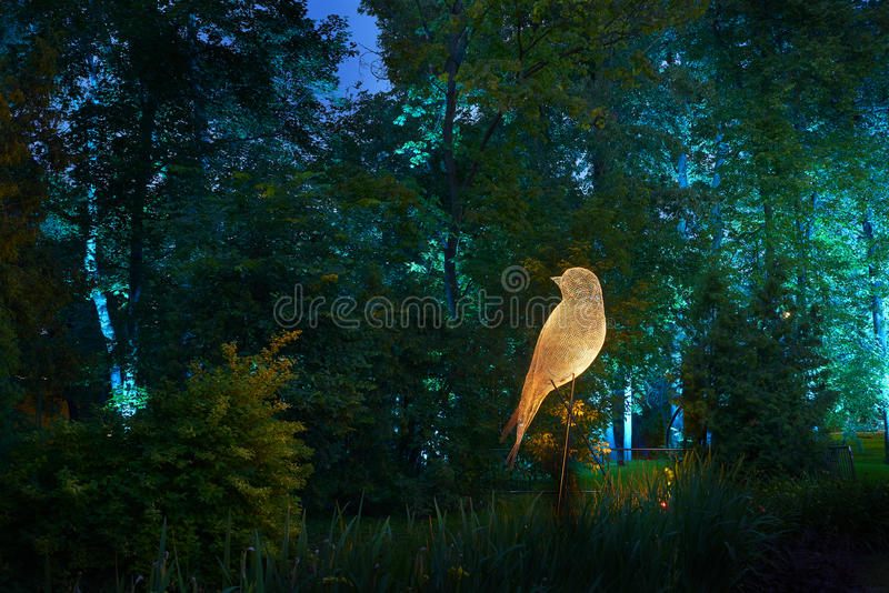 Night lights show `Inspiration` in Ostankino garden city park. Hundreds of lights in the forest. Amazing 3d light and laser illumi royalty free stock image