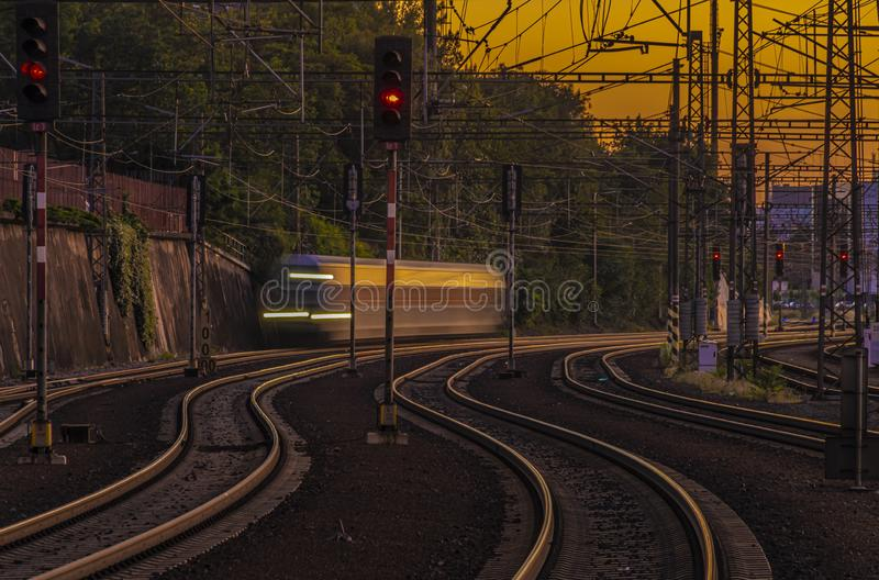 Night with lights view from platform in summer in Prague with passenger train. Night with lights view from platform in summer in capital Prague above royalty free stock photos