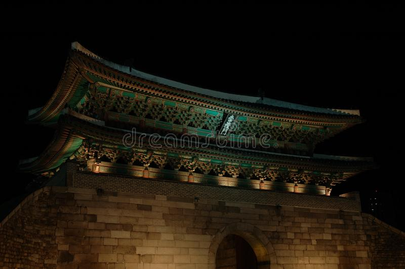 Night lit Korean city gate in Seoul royalty free stock images