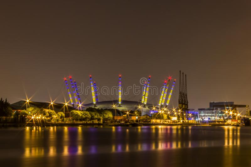 A night long exposure of the O2 Arena with reflection on the Thames river royalty free stock image