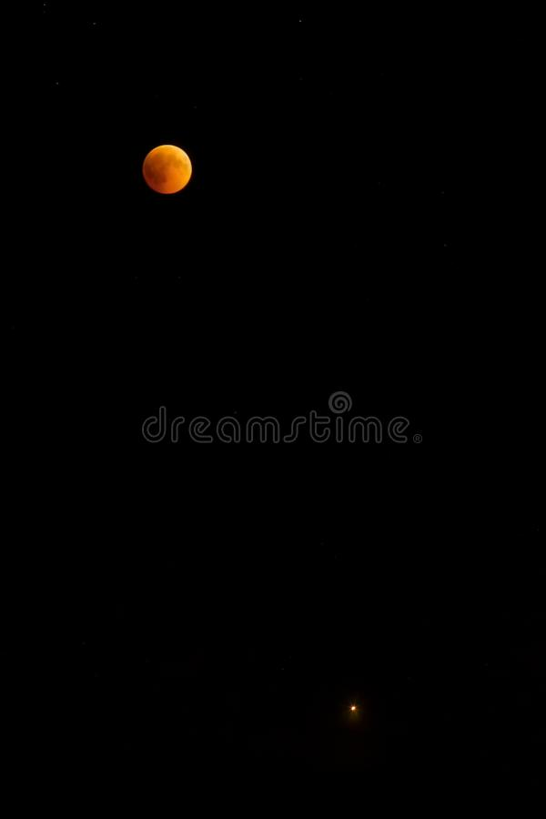 Night Lunar eclipse on a dark sky royalty free stock photography