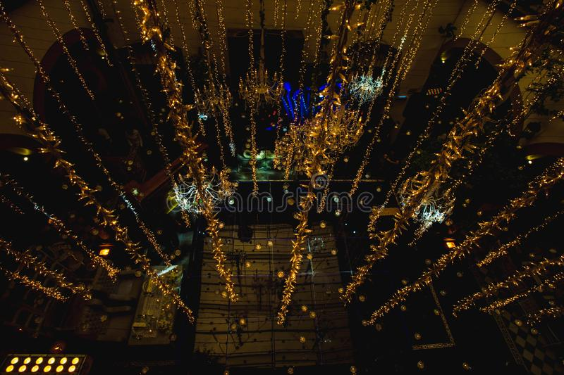 Night luxury wedding ballroom lights decoration for weddings, receptions. Decoration ideas with flowers, centerpieces, candles, romantic decoration for elegant stock image