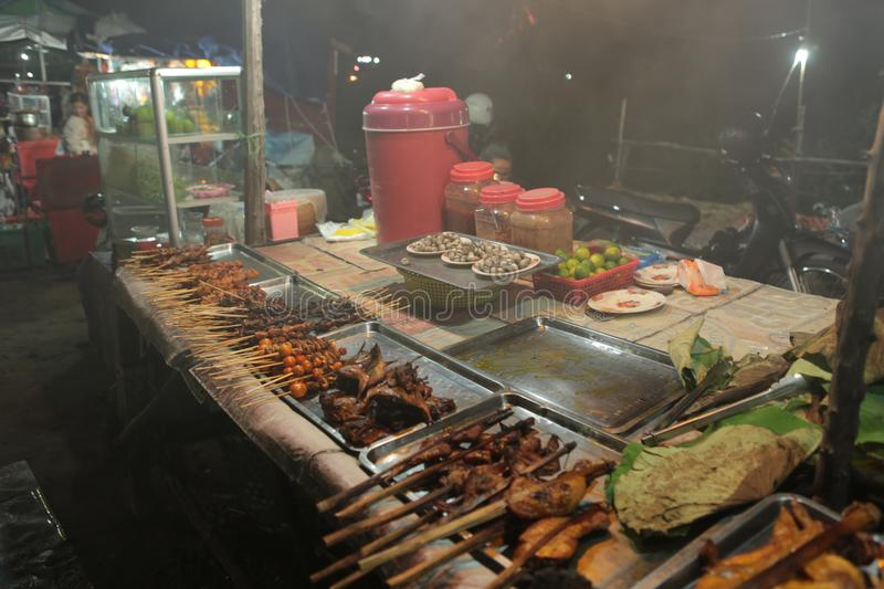 Night market in the street of Siem reap. The angkor night market in Siem Reap is one of the oldest night market in Cambodia. You can find many things as food and stock photography