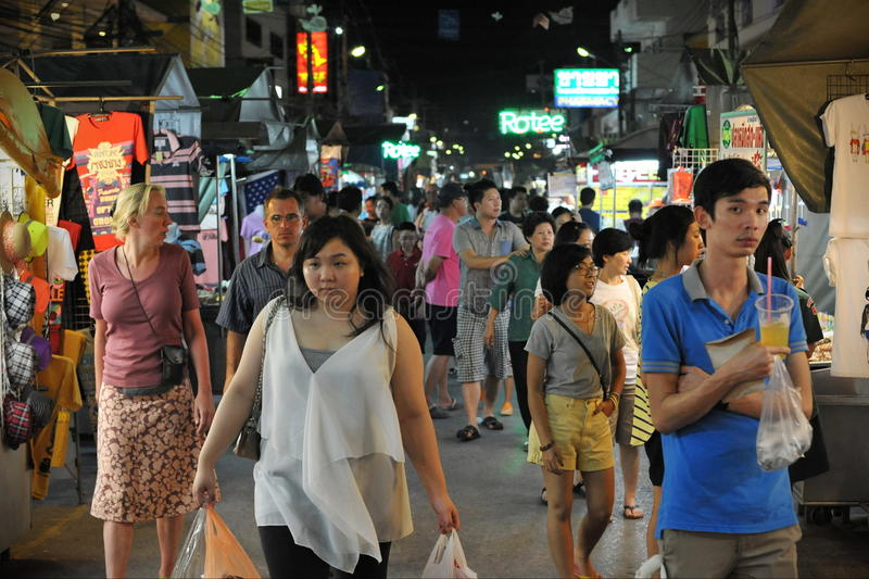 Night Market. Tourists and locals browse a night street market on October 26, 2012 in Hua Hin, Thailand. The famous night market is a popular tourist attraction royalty free stock photo