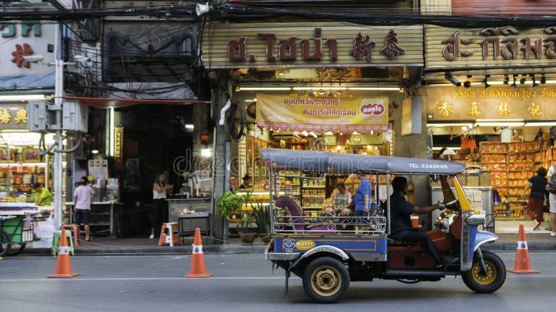 Night market and Tuk-Tuk (Taxi Thailand) on chinatown (Yaowarat) Road,the main street. Bangkok, Thailand - September 3, 2016: Night market and Tuk-Tuk (Taxi royalty free stock photo