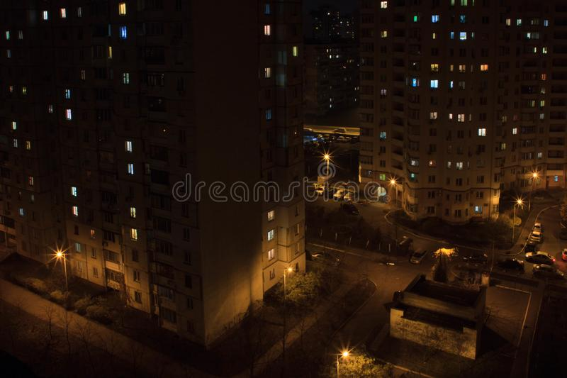Night midtown without anybody today. Suck a night photograpy of a Kiev`s midtown Poznyaky. It was taken at cold night and every body was in their home stock images