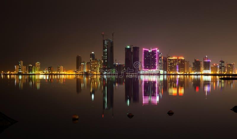 Night modern city skyline, Manama, Bahrain, Middle East. Night modern city skyline with shining neon lights and reflections in water. Manama, Bahrain, Middle stock photos