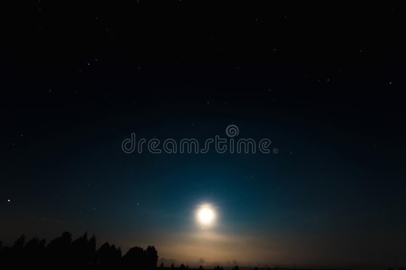 Night moon sky, full moon, Moon over the lake. Night landscape. Reflection of the rays from the moon in the water.  stock image