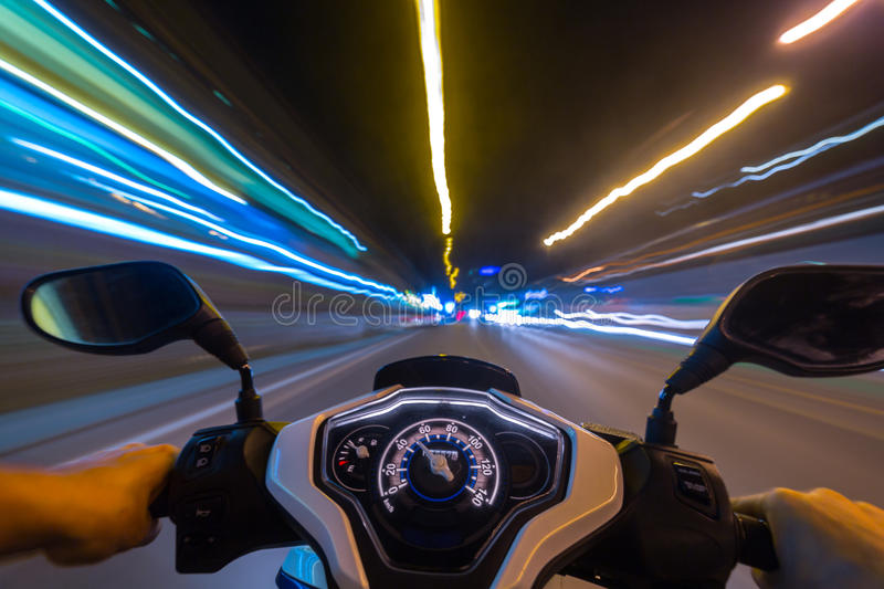 Night motorbike ride. Abstract speed motion background, night city motorbike ride, selective focus on speedometer royalty free stock images